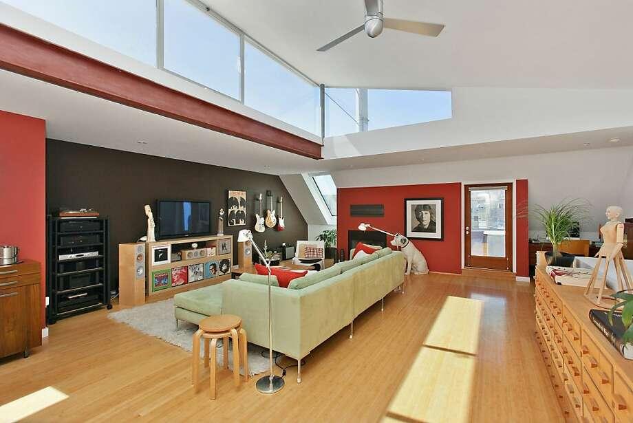 A bank of horizontal windows illuminates the living room. Photo: OpenHomesPhotography.com