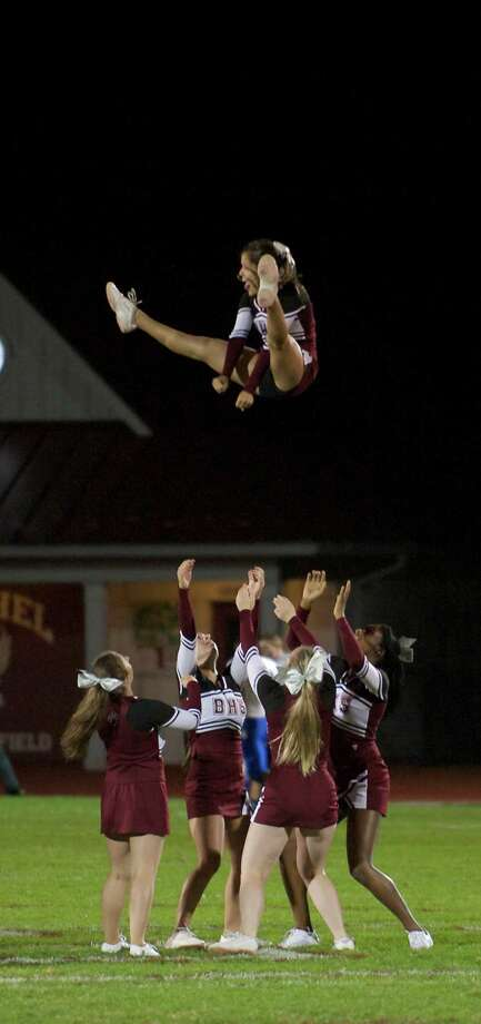 The Bethel High School cheerleaders perform during  half time of the boys football game between Bunnell High School and Bethel High School in Bethel, Conn, on Friday, October 11, 2013. Photo: H John Voorhees III / The News-Times Freelance