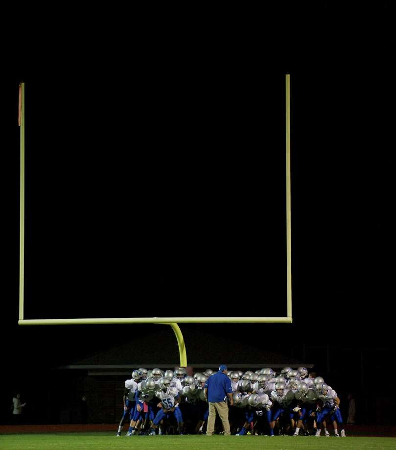 The Bunnell football team before the start of a game between Bunnell High School and Bethel High School in Bethel, Conn, on Friday, October 11, 2013. Photo: H John Voorhees III / The News-Times Freelance