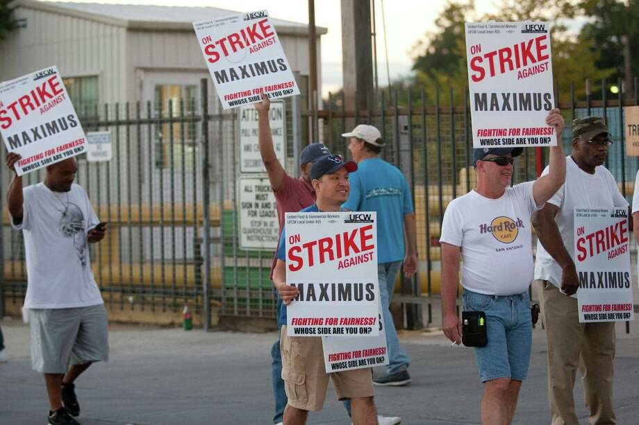 "A group of employees from Maximus Coffee Group, represented by the United Food and Commercial Workers Local 455, strike outside the facility on the 4000 block of Harrisburg on the East End Friday morning, Oct. 11, 2013, in Houston.  Union representative Scott Vinson said about 250 employees are striking the companyé¢Ã©""é´s plan to reduce wages from 25 to 50 percent per hour, reduce retirement benefits, increase insurance premiums, and eliminate overtime pay. Photo: Johnny Hanson, Staff / Houston Chronicle"