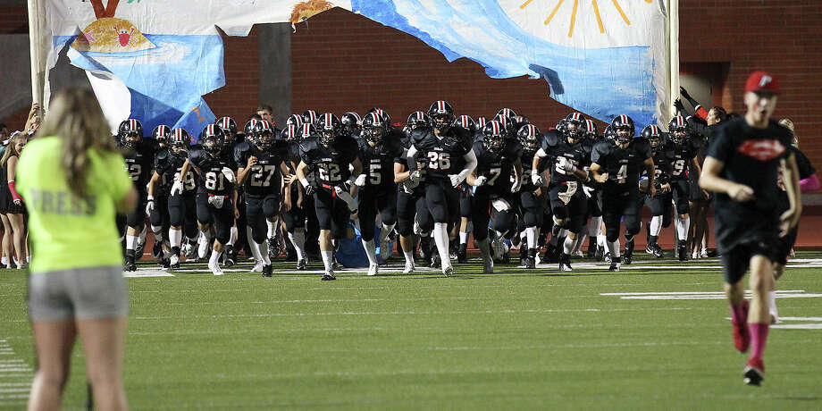 The Churchill Chargers take the field for their game against the Johnson Jaguars at Heroes Stadium on Friday, Oct. 11, 2013. Photo: Kin Man Hui, San Antonio Express-News / ©2013 San Antonio Express-News