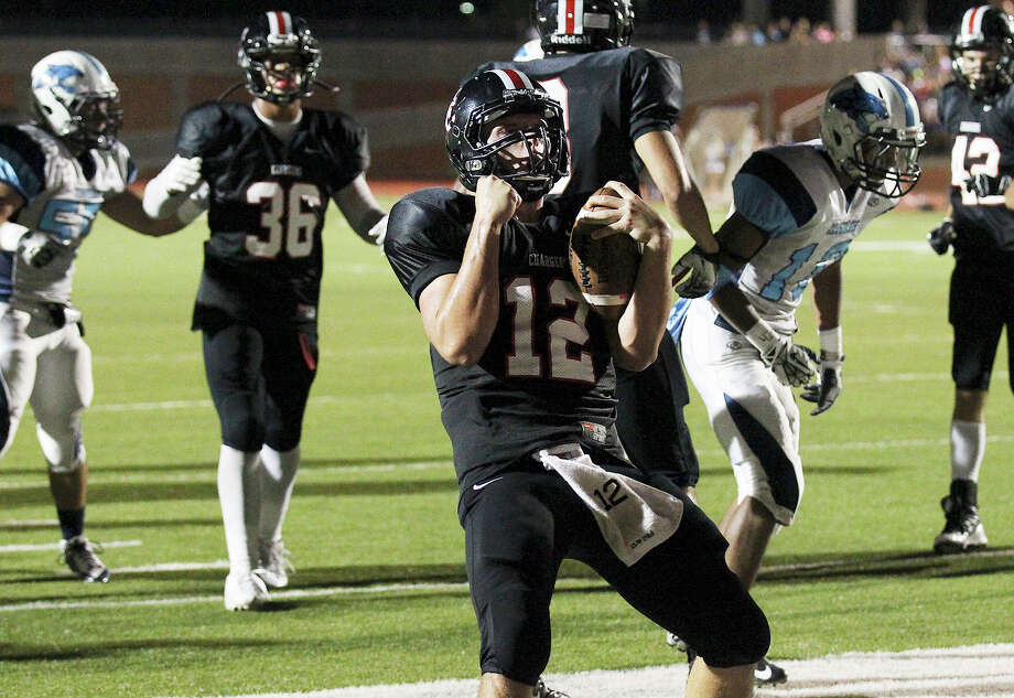 Churchill Chargers quarterback Nate Pearson (12) celebrates after scoring a short-yardage touchdown against the Johnson Jaguars at Heroes Stadium on Friday, Oct. 11, 2013. Photo: Kin Man Hui, San Antonio Express-News / ©2013 San Antonio Express-News
