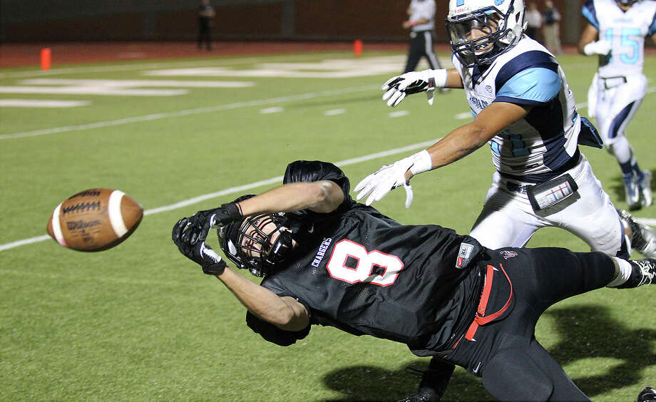Churchill Chargers' Lucas Saenz (08) just misses a catch against  Johnson Jaguars' R.J. Espinoza (21) at Heroes Stadium on Friday, Oct. 11, 2013. Photo: Kin Man Hui, San Antonio Express-News / ©2013 San Antonio Express-News