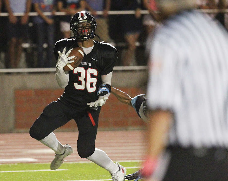 Churchill Chargers' Dimitri Flowers (36) makes a one-armed grab for a touchdown against the Johnson Jaguars at Heroes Stadium on Friday, Oct. 11, 2013. Photo: Kin Man Hui, San Antonio Express-News / ©2013 San Antonio Express-News