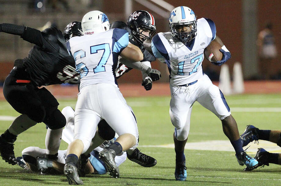 Johnson Jaguars' Braedon Williams (17) looks for room to run against the Churchill Chargers at Heroes Stadium on Friday, Oct. 11, 2013. Photo: Kin Man Hui, San Antonio Express-News / ©2013 San Antonio Express-News