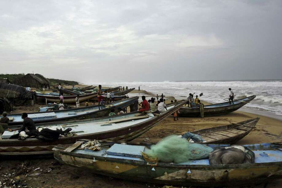 """The Indian Meteorological Department warned that a massive cyclone Phailin was a """"very severe cyclonic storm"""" that was expected to hit India's eastern seaboard. Photo: Biswaranjan Rout / Associated Press"""
