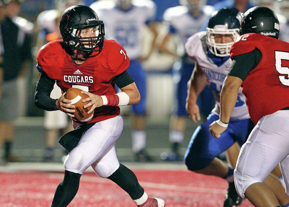 Cougar quarterback Philip Shelton steps back to pass as Canyon hosts New Braunfels in the Wurst Bowl at Canyon High School Stadium on October 11, 2013. Photo: TOM REEL