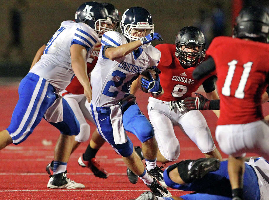 New Braunfels wide receiver Austin Orgeron trie to cut away from defenders as Canyon hosts New Braunfels in the Wurst Bowl at Canyon High School Stadium on October 11, 2013. Photo: Tom Reel, San Antonio Express-News