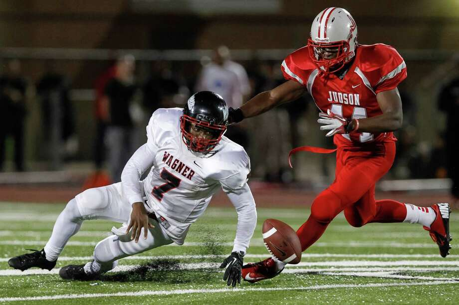 """Wagner quarterback Tekoa Bryant-McKinnies (left) tries to beat Judson's De'ontray Ellison to the football after a second half fumble in the """"Hammer Bowl"""" at Rutledge Stadium on Friday, Oct. 11, 2013.  MARVIN PFEIFFER/ mpfeiffer@express-news.net Photo: Marvin Pfeiffer, San Antonio Express-News / Express-News 2013"""