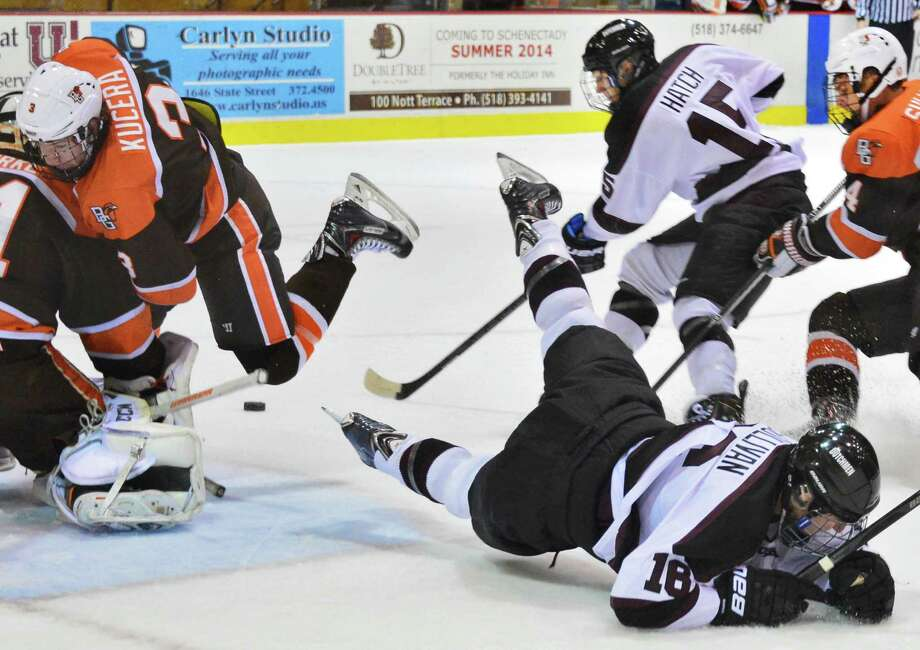 Union's #15 Matt Hatch scores as teammate Kevin Sullivan, bottom, is upended during their season opener against Bowling Green at Mesa Rink Friday Oct. 11, 2013, in Schenectady, NY.  (John Carl D'Annibale / Times Union) Photo: John Carl D'Annibale / 00024173A