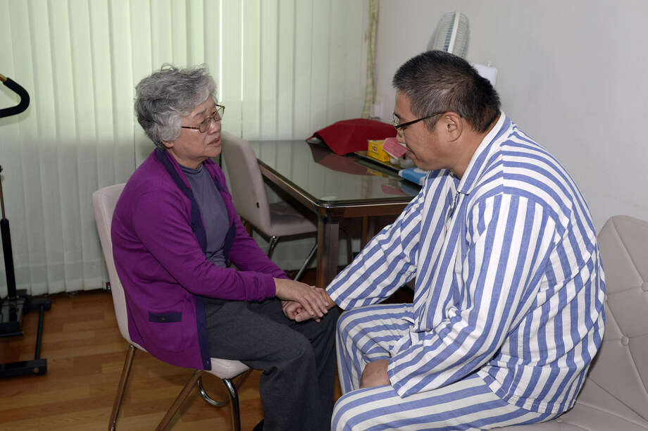 "Kenneth Bae, a Korea-American Christian missionary who was accused and later detained by North Korea for ""subversive acts,""visits with his mother Myunghee Bae. Photo: Mun Kwang Son / Associated Press"