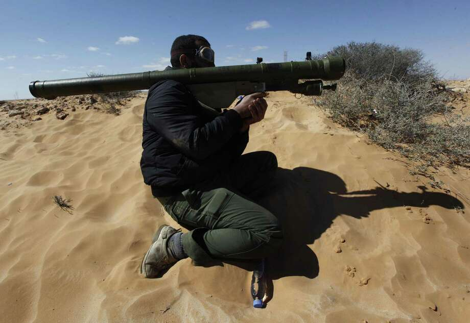 A new independent report warns that portable anti-aircraft systems, such as this Russian SA-7 model brandished by a Libyan rebel, are at risk of falling into the hands of terrorists. The Syrian government is believed to have 20,000 missile launchers. Photo: Hussein Malla / Associated Press