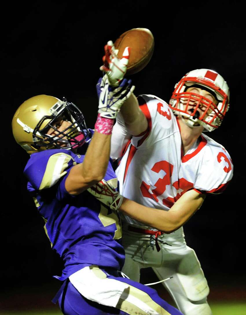Guilderland's Cameron Long, right, knocks away a pass intended for CBA's Alex Koshgarian during their football game on Friday, Oct. 11, 2013, at Christian Brothers Academy in Colonie, N.Y. (Cindy Schultz / Times Union)