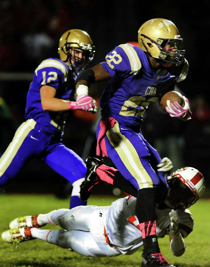CBA's Elliot Croskey, right, plows through a tackle from Guilderland's Micaiah Henningham and makes a touch down during their football game on Friday, Oct. 11, 2013, at Christian Brothers Academy in Colonie, N.Y. (Cindy Schultz / Times Union)