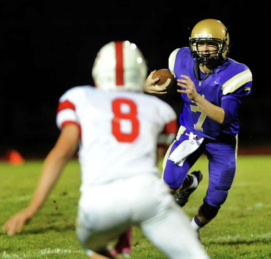 CBA's quarterback Joe Kolbe, right, runs the ball as Guilderland's Andrew Sentz defends during their football game on Friday, Oct. 11, 2013, at Christian Brothers Academy in Colonie, N.Y. (Cindy Schultz / Times Union) Photo: Cindy Schultz / 00024204A