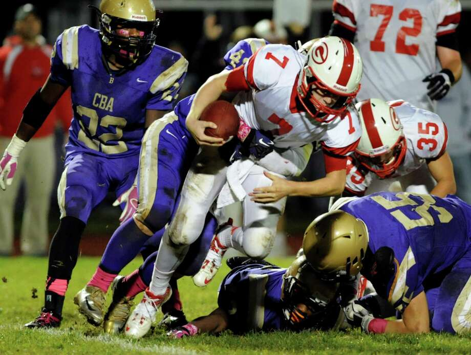 Guilderland's quarterback Frank Gallo, center, gets sacked from behind by CBA's Connor Cushine during their football game on Friday, Oct. 11, 2013, at Christian Brothers Academy in Colonie, N.Y. (Cindy Schultz / Times Union) Photo: Cindy Schultz / 00024204A