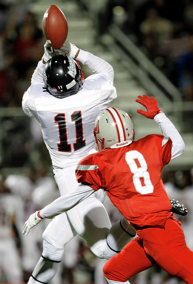 "Wagner's Xavier La Grant (left) tries to catch a pass as Judson's Dominic Cameron defends during the first half of the ""Hammer Bowl"" at Rutledge Stadium on Friday, Oct. 11, 2013.  MARVIN PFEIFFER/ mpfeiffer@express-news.net Photo: Marvin Pfeiffer, San Antonio Express-News / Express-News 2013"