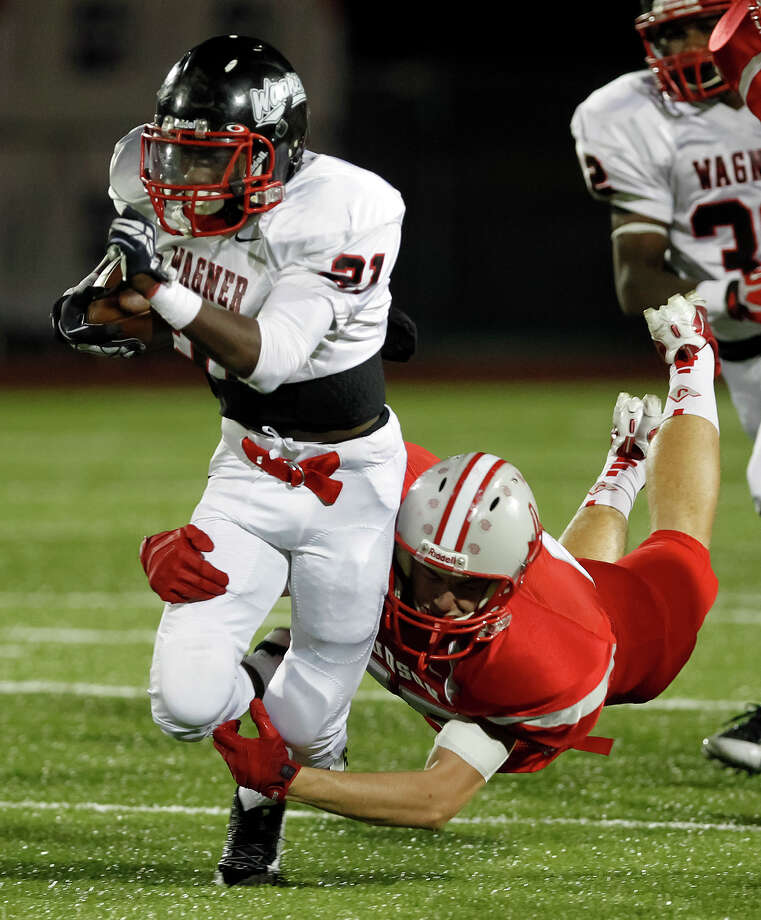 "Wagner's Brandon Burr (left) is brought down from behind by Judson's Corey Mika during the first half of the ""Hammer Bowl"" at Rutledge Stadium on Friday, Oct. 11, 2013.  MARVIN PFEIFFER/ mpfeiffer@express-news.net Photo: Marvin Pfeiffer, San Antonio Express-News / Express-News 2013"