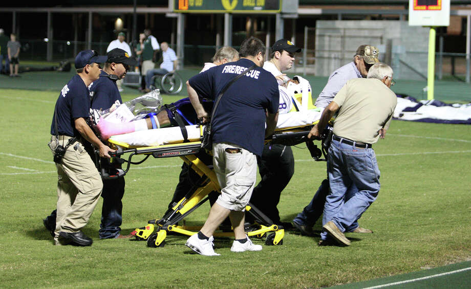 Kevin Shorter is transported from the field on a stretcher after a collision with another player towards the end of the first half of the game against East Chambers Friday at Buccaneer Stadium in Winnie, TX. (Matt Billiot / Special to the Enterprise)