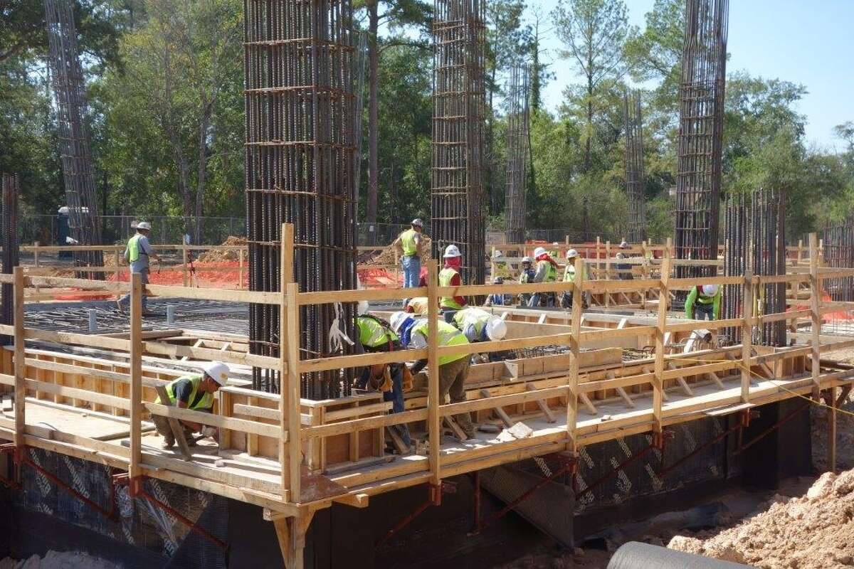 Thousands of construction workers pound away daily on structures in the Springwood project.