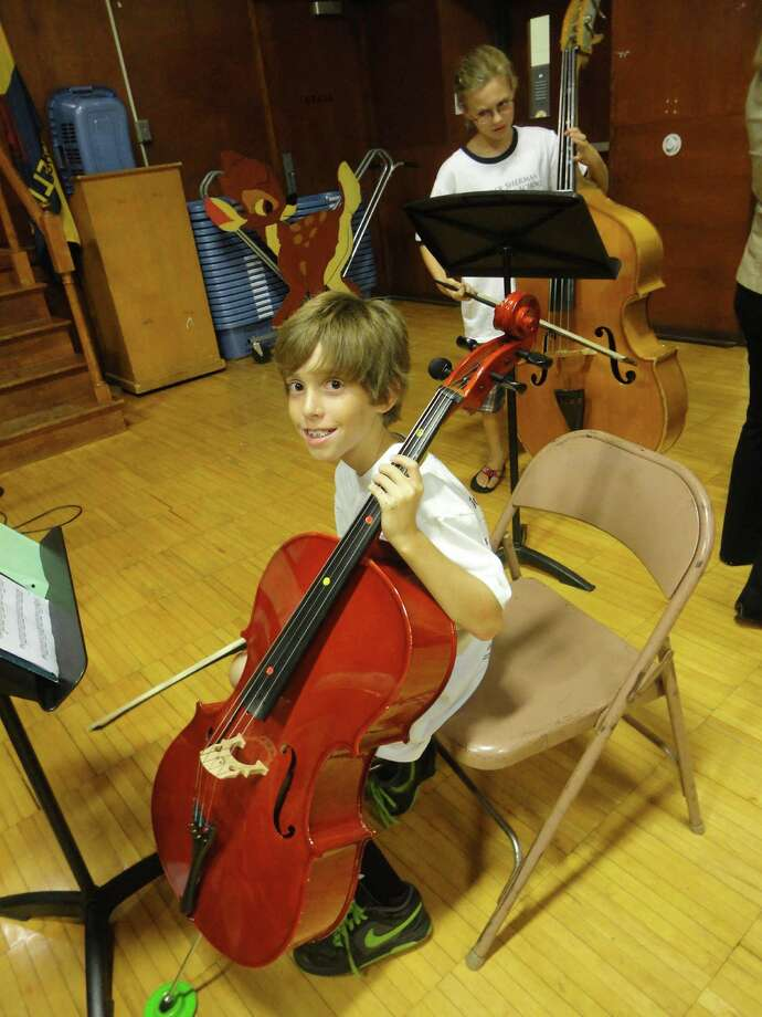 Cole Spencer, 10, played the cello when the fifth-grade string musicians performed at the Sherman School 100th anniversary reception Friday. FAIRFIELD CITIZEN, CT 10/11/13 Photo: Meg Barone / Fairfield Citizen contributed