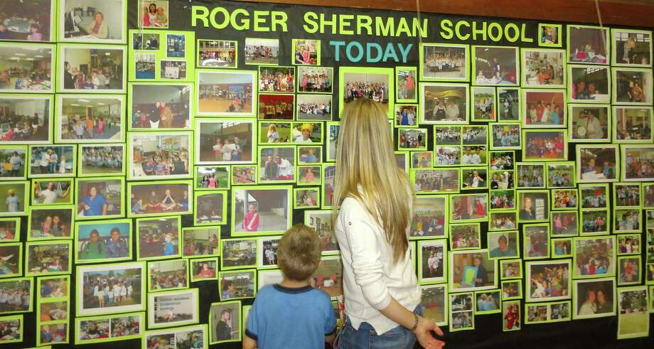 The centennial celebration at Roger Sherman School on Friday highlighted the school's past and present with displays of photos, art work, news clippings and yearbooks. FAIRFIELD CITIZEN, CT 10/11/13 Photo: Meg Barone / Fairfield Citizen contributed