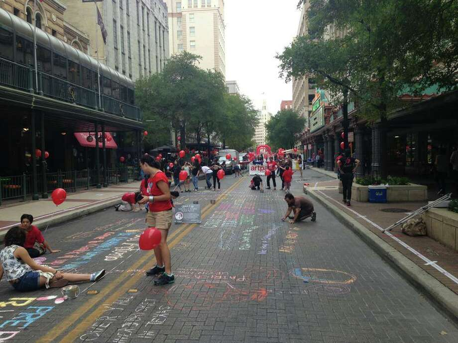 Chalk It Up gets started on Houston Street Saturday morning.