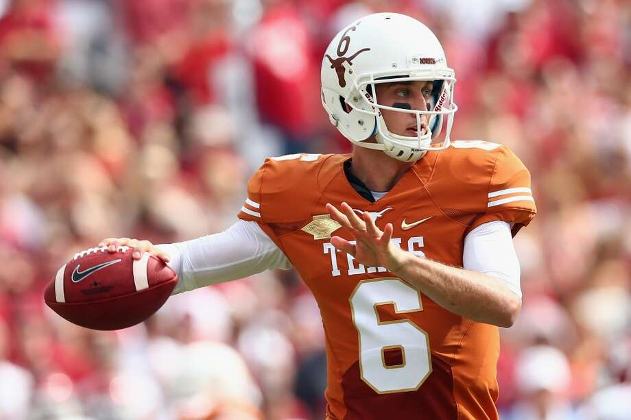 Texas quarterback Case McCoy looks to pass during the first quarter. Photo: Tom Pennington, Getty Images