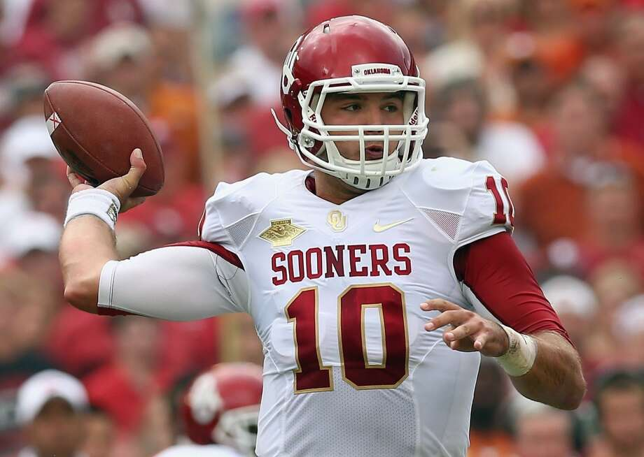 Oklahoma quarterback Blake Bell looks to pass during the first half. Photo: Tom Pennington, Getty Images