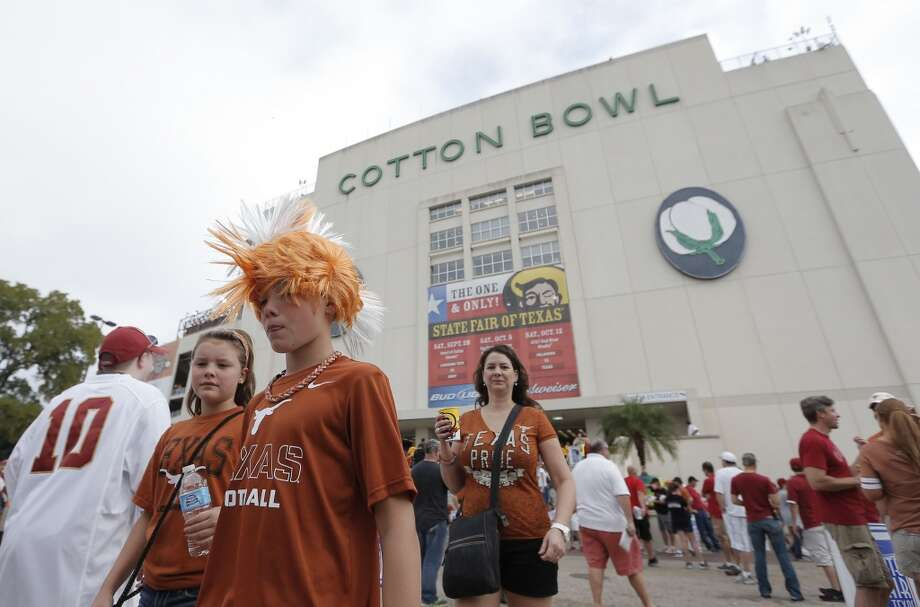 Texas fans walks outside the Cotton Bowl before the game. Photo: Brandon Wade, Associated Press