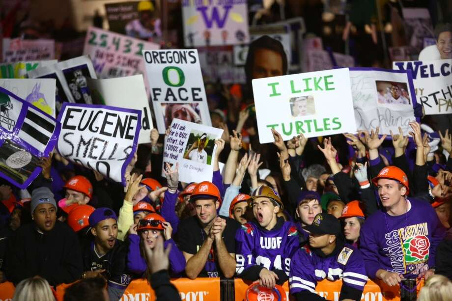 "UW students and fans hold signs and cheer behind the set of ESPN's ""College GameDay"" at UW's Red Square on Saturday. Photo: Joshua Trujillo, Seattlepi.com"