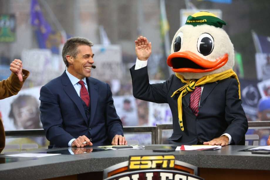 """ESPN """"College GameDay"""" host Lee Corso, right, wears the head of The Oregon Duck mascot after he chose Oregon to beat Washington. Washington State is hosting Gameday this Saturday as the Cougs play Oregon. Photo: Joshua Trujillo, Seattlepi.com"""