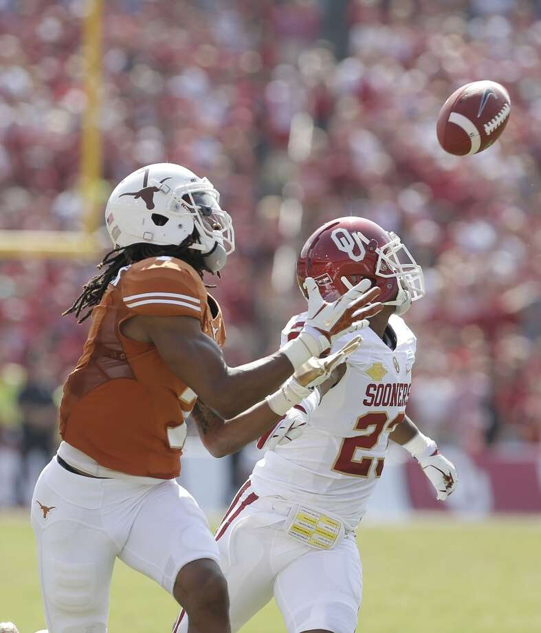 Texas wide receiver Marcus Johnson (7) catches a touchdown pass agains Oklahoma defensive back Kass Everett (23) during the first half. Photo: Brandon Wade, Associated Press