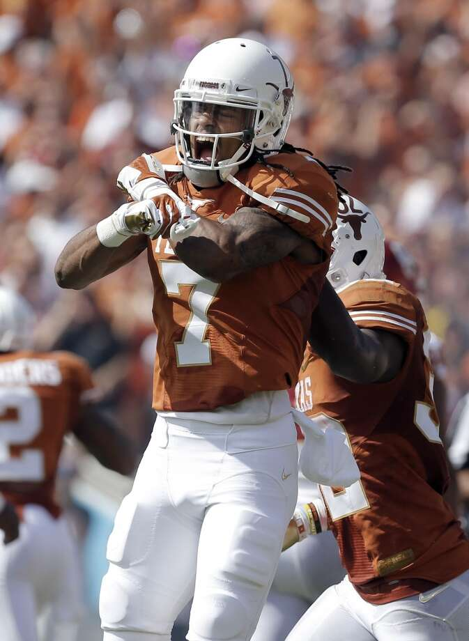 Texas wide receiver Marcus Johnson (7) yells as he celebrates after catching a touchdown pass during the first half. Photo: Brandon Wade, Associated Press