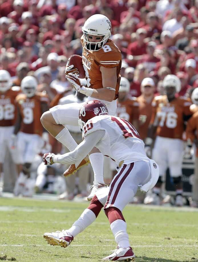 Texas wide receiver Jaxon Shipley (8) catches a pass against Oklahoma defensive back Quentin Hayes (10) during the first half. Photo: Brandon Wade, Associated Press