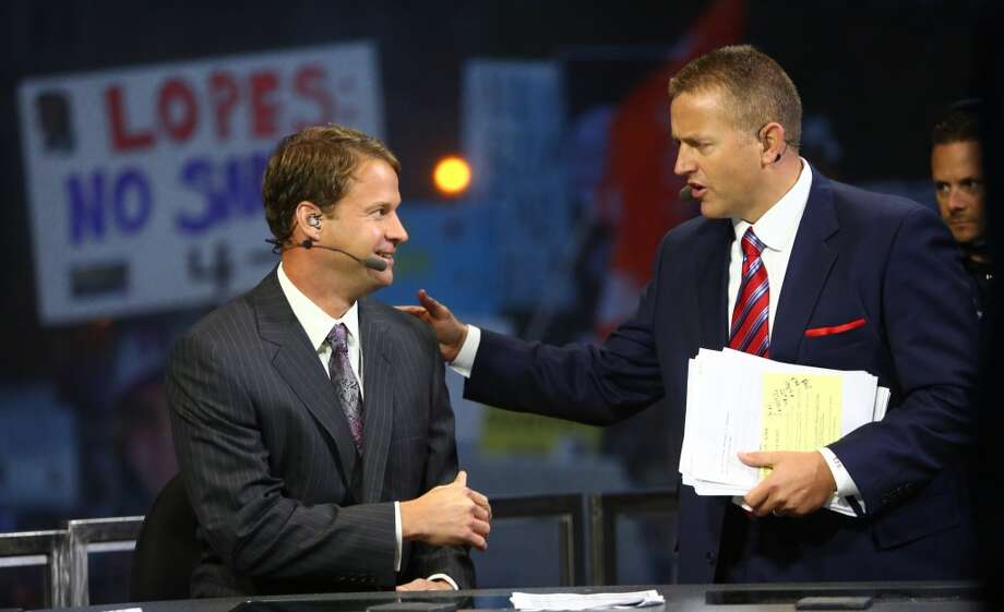 Recently fired USC coach Lane Kiffin, left, speaks to broadcaster Kirk Herbstreit before his first interview since being fired during a broadcast of ESPN's College Game Day in Red Square on the University of Washington campus. It was the first time the popular show has been broadcast from Seattle. Photographed on Saturday, October 12, 2013.  (Joshua Trujillo, seattlepi.com) Photo: SEATTLEPI.COM