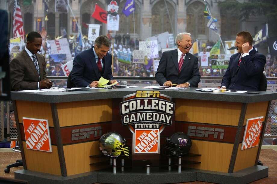 From left, broadcasters Desmond Howard, Chris Fowler, Lee Corso and Kirk Herbstreit talk during a broadcast of ESPN's College Game Day in Red Square on the University of Washington campus. It was the first time the popular show has been broadcast from Seattle. Photographed on Saturday, October 12, 2013.  (Joshua Trujillo, seattlepi.com) Photo: SEATTLEPI.COM