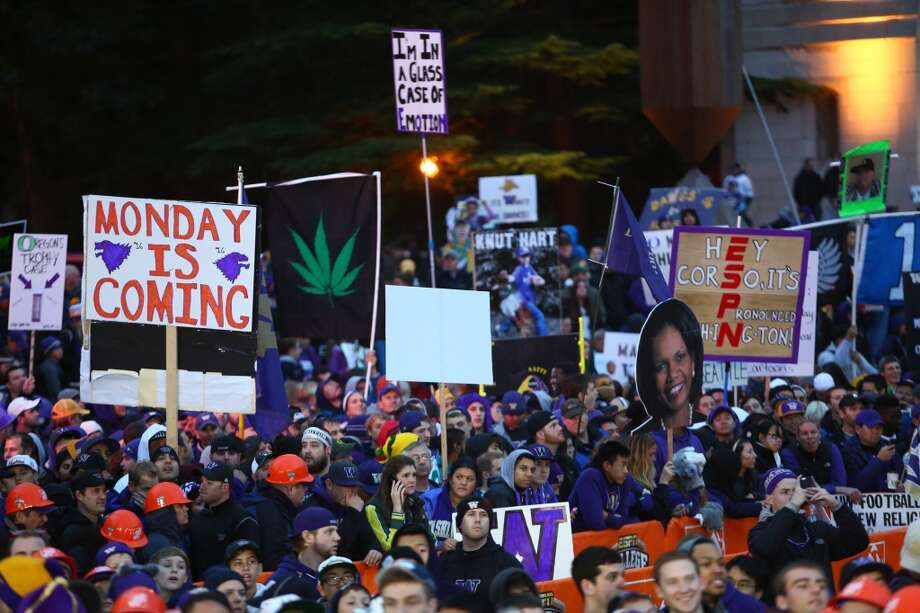 Fans hold signs during a broadcast of ESPN's College Game Day in Red Square on the University of Washington campus. It was the first time the popular show has been broadcast from Seattle. Photographed on Saturday, October 12, 2013.  (Joshua Trujillo, seattlepi.com) Photo: SEATTLEPI.COM