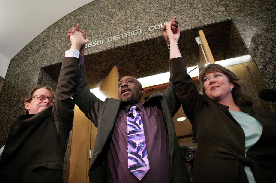 James Woodard, center, celebrates outside the 265th District Court with Innocence Project Texas director Jeff Blackburn and Assistant Public Defender Michelle Moore in Dallas on April 29, 2008. Woodard was exonerated for a 1981 strangulation and rape.  Photo: Jim Mahoney, MBR / The Dallas Morning News