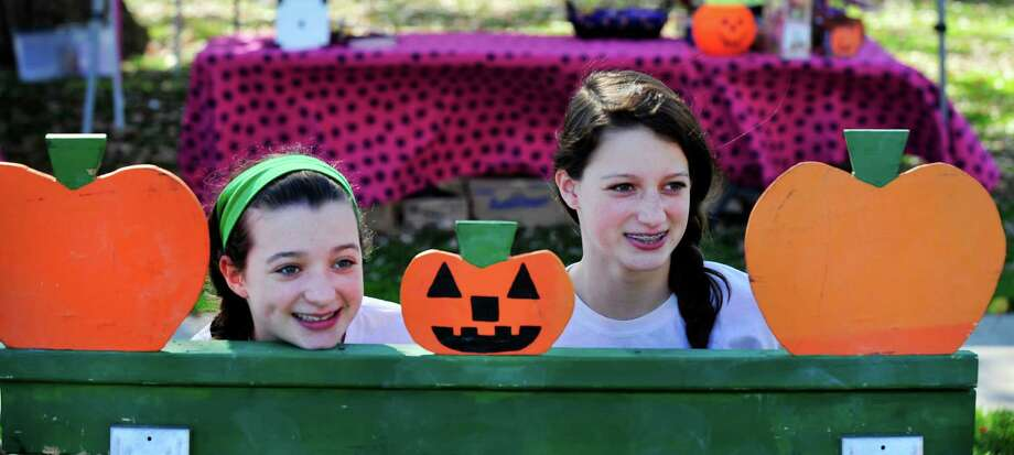 Rachel Colegrove, 12, left, and her sister, Madeline, 15, are on the line at the pumpkin toss during at the Newtown Pumpkin Festival on the Fairfield Hills Campus in Newtown, Conn. Saturday, Oct. 12, 2013. Photo: Michael Duffy / The News-Times