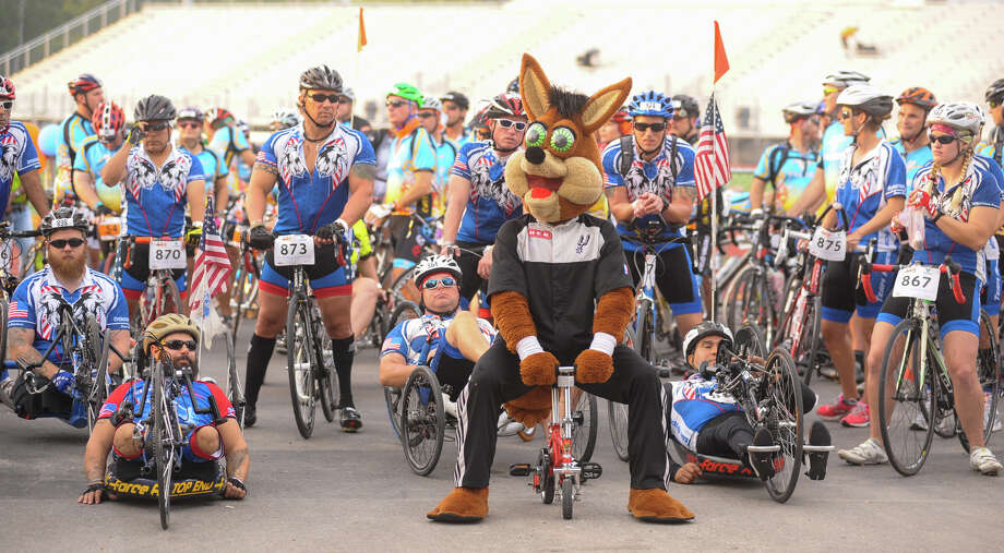 The Spurs Coyote get ready to lead riders at the start of the Bike MS: Valero 2013 Alamo Ride to the River Presented by HEB at Wheatley Sports Complex Saturday morning. Photo: Robin Jerstad