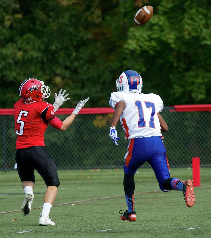 New Canaan's Graham Wagner makes a catch and runs for a touchdown during Saturday's football game at New Canaan High School on October 12, 2013. Photo: Lindsay Perry / Stamford Advocate