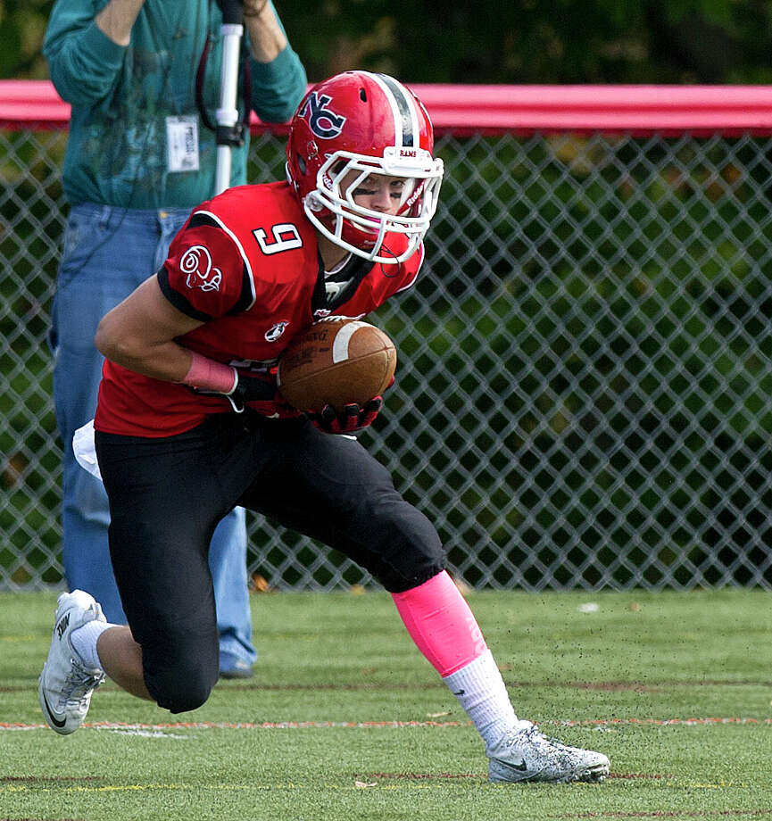 New Canaan's Cole Turpin makes a catch for a touchdown during Saturday's football game at New Canaan High School on October 12, 2013. Photo: Lindsay Perry / Stamford Advocate