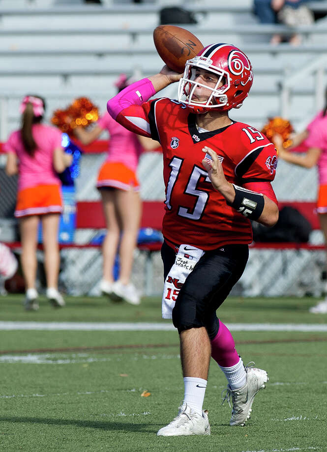 New Canaan's Nick Cascione throws a pass during Saturday's football game at New Canaan High School on October 12, 2013. Photo: Lindsay Perry / Stamford Advocate