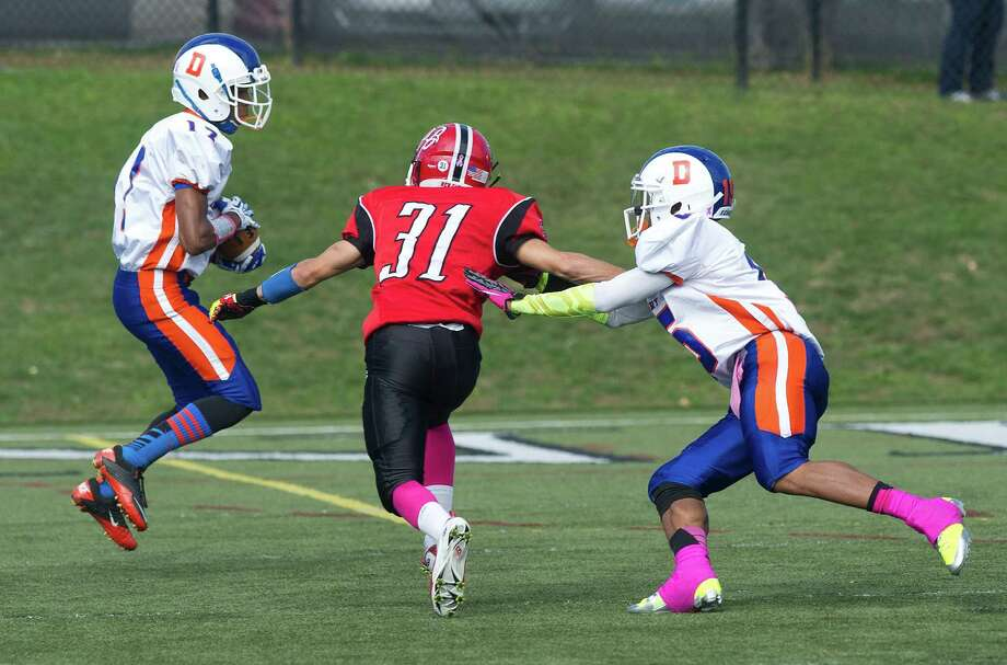 Saturday's football game against Danbury at New Canaan High School on October 12, 2013. Photo: Lindsay Perry / Stamford Advocate