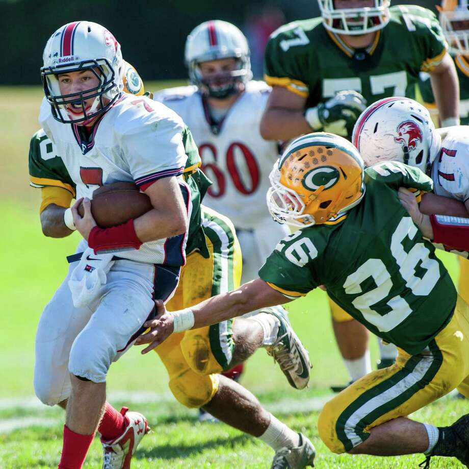 Foran high school quarterback Jake Kasuba struggles for some extra yardage during a football game against Trinity Catholic high school played at Trinity in Stamford, CT on Saturday, October, 12th, 2013 Photo: Mark Conrad / Stamford Advocate Freelance