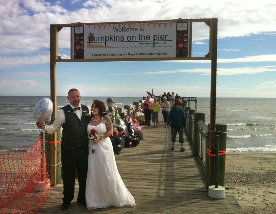 Leanne and Paul Lovgren, of Milford, tie the knot before Justice of the Peace Sonia Lofton on Walnut Beach in Milford Saturday afternoon at the Pumpkins on the Pier festival. Photo: Dan Tepfer / Connecticut Post