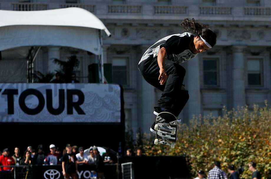 David Gonzalez grabs air practicing for the street skate competition at the Dew Tour's San Francisco stop. Photo: Raphael Kluzniok, The Chronicle