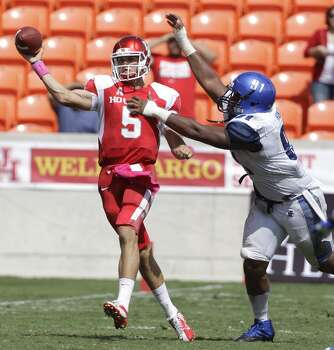 Quarterback John O'Korn is pressured by Ricky Hunter during the third quarter. Photo: Melissa Phillip, Houston Chronicle