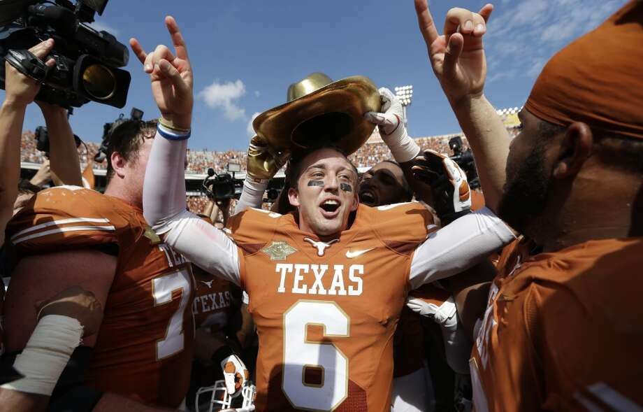 Texas 36, Oklahoma 20Texas quarterback Case McCoy celebrates with teammates after the win at the Cotton Bowl in Dallas. Photo: LM Otero, Associated Press